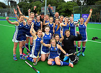 The Havelock North team celebrates winning the 2017 Jenny Hair Cup girls hockey final between Whanganui High School (green and yellow) and Havelock North High School (blue and white) at Hockey Manawatu Twin Turfs in Palmerston North, New Zealand on Friday, 8 September 2017. Photo: Dave Lintott / lintottphoto.co.nz