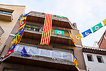 Catalonia Referendum Posters  and flags on Carrer Major in  Sant Cugat, Barcelona, Catalonia ahead of the planned October 1st independence vote. The Spanish authorities have clamped down on the publishing of referendum materials by the Catalan independence movement, so ordinary people have started printing, distributing and displaying posters.