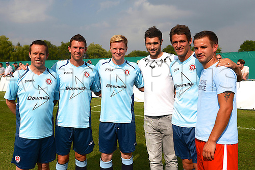 07.09.2014.  Poole, England. Charity match in aid of MND sufferer Andrew Culliford. Russell Beardsmore (ex-Man Utd), Stephen Purches (ex-AFC Bournemouth), AFC Bournemouth manager Eddie Howe, CHarlie Austin (QPR, ex-Poole Town), Jason Tindall (AFC Bournemouth asst manager), Micky Hubbard (Poole Town)