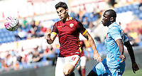 Calcio, Serie A: Roma vs Napoli. Roma, stadio Olimpico, 25 aprile 2016.<br /> Roma&rsquo;s Diego Perotti, left, and Napoli&rsquo;s Kalidou Koulibaly fight for the ball during the Italian Serie A football match between Roma and Napoli at Rome's Olympic stadium, 25 April 2016. <br /> UPDATE IMAGES PRESS/Isabella Bonotto