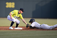 Second baseman Chandler Avant (3) of the Columbia Fireflies tags out Isaiah Pasteur of the Charleston RiverDogs in a game on Saturday, April 6, 2019, at Segra Park in Columbia, South Carolina. Columbia won, 3-2. (Tom Priddy/Four Seam Images)