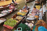 Thai women preparing food, Damnoen Saduak Floating Market, Damnoen Saduak, Thailand