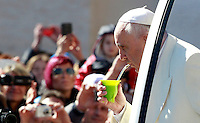 Papa Francesco beve mate offerto da un fedele al suo arrivo all'udienza generale del mercoledi' in Piazza San Pietro, Citta' del Vaticano, 16 aprile 2014.<br /> Pope Francis drinks from a mate gourd, a traditional South AMerican cup, offered by a pilgrim as he arrives for his weekly general audience in St. Peter's Square at the Vatican, 16 April 2014.<br /> UPDATE IMAGES PRESS/Isabella Bonotto<br /> <br /> STRICTLY ONLY FOR EDITORIAL USE
