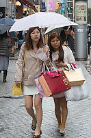 Young lady with shopping bags in street in Tokyo