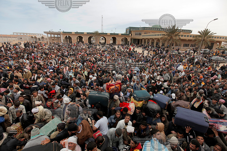 Chaos at the border. Tens of thousands of people, mainly Egyptian workers, flee unrest in Libya and cross the border into Tunisia. Some slept in the open for several days before being processed.  At the same time forces loyal to Col. Gaddafi fought opposition forces in various parts of the country.