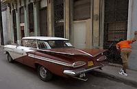 street scene with brown oldtimer, Havana, Cuba