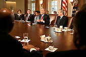 Washington, D.C. - April 5, 2005 -- United States President George W. Bush meets with his cabinet in the Cabinet Room of the White House in Washington, D.C. on April 5, 2005. United States Secretary of State Condolezza Rice is seated at the President's right and United States Department of Defense Donald Rumsfeld is at the President's left.<br /> Credit: Martin Simon - Pool via CNP