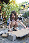 Berkeley CA, Girl, seven, working on carpentry project  MR