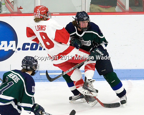 Holly Lorms (BU - 8), Melissa Lacroix (Mercyhurst - 8) - The Boston University Terriers defeated the visiting Mercyhurst College Lakers 4-2 in their NCAA Quarterfinal matchup on Saturday, March 12, 2011, at Walter Brown Arena in Boston, Massachusetts.