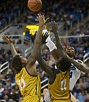 Nevada's Jordan Caroline shoots over the California Baptist defense in the second half of an NCAA college basketball game in Reno, Nev., Monday, Nov. 19, 2018. (AP Photo/Tom R. Smedes)