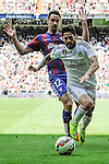 Real Madrid´s Isco and Eibar´s Borja Fernandez during 2014-15 La Liga match between Real Madrid and Eibar at Santiago Bernabeu stadium in Madrid, Spain. April 11, 2015. (ALTERPHOTOS/Luis Fernandez)