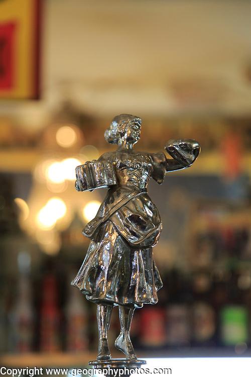 Antique beer pump metal female figure, inside famous historic Los Gatos Cervecerias bar, Madrid, Spain