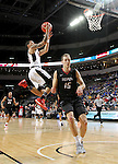 SIOUX FALLS, SD: MARCH 6: 	Marcus Tyus #23 from Omaha lays the ball up past Matt O'Leary #15 from IUPUI during the Summit League Basketball Championship on March 6, 2017 at the Denny Sanford Premier Center in Sioux Falls, SD. (Photo by Dave Eggen/Inertia)