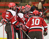 George Hughes (St. Lawrence - 15), ?, Aaron Bogosian (St. Lawrence - 32), ? and Greg Carey (St. Lawrence - 10) celebrate Carey's goal which made it 4-3 at 17:05 of the third. - The Harvard University Crimson defeated the St. Lawrence University Saints 4-3 on senior night Saturday, February 26, 2011, at Bright Hockey Center in Cambridge, Massachusetts.