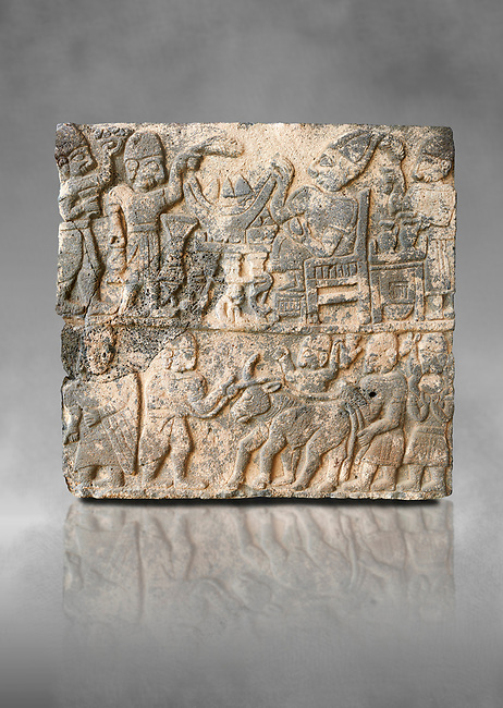 Pictures & images of the South Gate Hittite sculpture stele depicting Hittite Gods. 8th century BC. Karatepe Aslantas Open-Air Museum (Karatepe-Aslantaş Açık Hava Müzesi), Osmaniye Province, Turkey.  Against grey art background