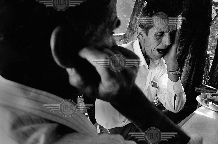 Two men chant the traditiobnal harmony during a marriage ceremony..