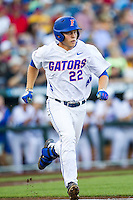 Florida Gators designated hitter JJ Schwarz (22) runs to first base against the Miami Hurricanes in the NCAA College World Series on June 13, 2015 at TD Ameritrade Park in Omaha, Nebraska. Florida defeated Miami 15-3. (Andrew Woolley/Four Seam Images)