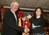 Jennifer Imus of Wells Fargo congratulates and presents the Red Lantern to Glenn Lockwood.