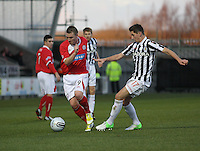 Andy Jackson takes the ball from Kenny McLean in the St Mirren v Brechin City William Hill Scottish Cup Round 4 match played at St Mirren Park, Paisley on 1.12.12.