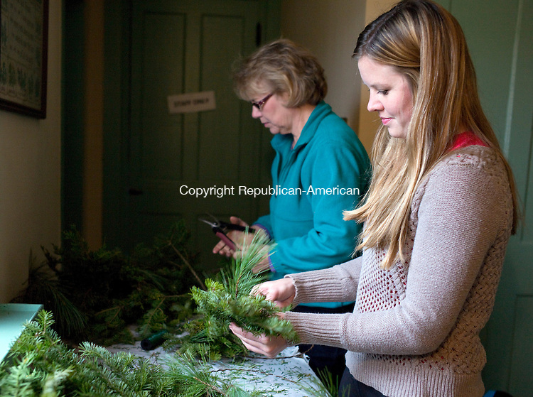Bethlehem, CT- 28 November 2015-112815CM04-  Heather Quinion of Bristol, right and her mom Donna Quinion of Litchfield make wreaths during a workshop at the Bellamy-Ferriday House in Bethlehem on Saturday. Approximately 20 people attended the event which was put on by horticulturists George and Carol McCleary.  Another workshop will be held on Tuesday December 1st, from 7 p.m. until 9 p.m. The cost is $25 per wreath per family or individual, including materials and admission to the house, and $20 for Connecticut Landmarks members. Pre-registration is required.  To register call the Bellamy-Ferriday House at 203-2667596, or send an email to bellamy.ferriday@ctlandmarks.org.   Christopher Massa Republican-American