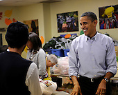 United States President Barack Obama talks with customers as he packs and gives bags of food to area residents at Martha's Table on Wednesday, November 24, 2010, in Washington, DC.  .Credit: Leslie E. Kossoff - Pool via CNP