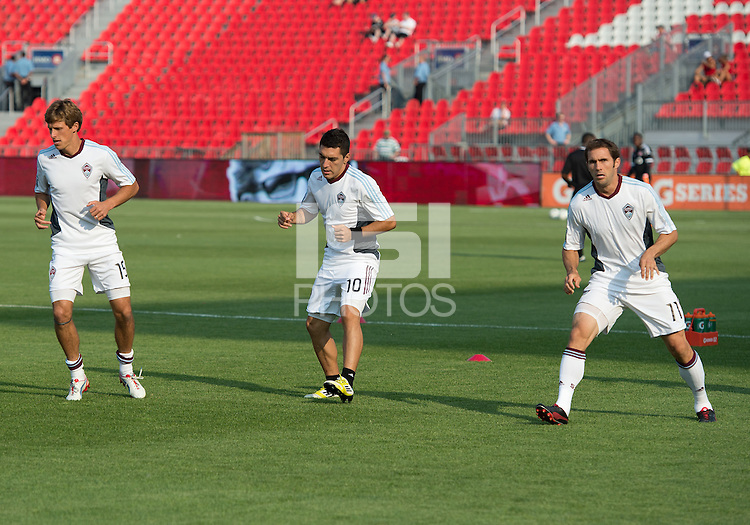 18 July 2012: Colorado Rapids midfielder Wells Thompson #15,Colorado Rapids midfielder Martin Rivero #10 and Colorado Rapids midfielder Brian Mullan #11 take warm-up during an MLS game between the Colorado Rapids and Toronto FC at BMO Field in Toronto, Ontario..Toronto FC won 2-1..