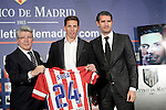 Atletico de Madrid's new player Jose Sosa with the President Enrique Cerezo (l) and the General Manager Jose Luis Perez Caminero (r) during his official presentation. January 3, 2014. (ALTERPHOTOS/Acero)