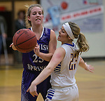 Spanish Springs Cougars Mackenzie O'Connell passes as Reed Raiders Gabby Kahl defends in their basketball game played on Friday night, February 10, 2017 at Reed High School in Sparks, Nevada.