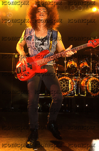Ratt - bass player Juan Croucier performing live on the Detonator Tour at the Town & Country Club in London UK - 30 Oct 1990.  Photo credit: George Chin/IconicPix