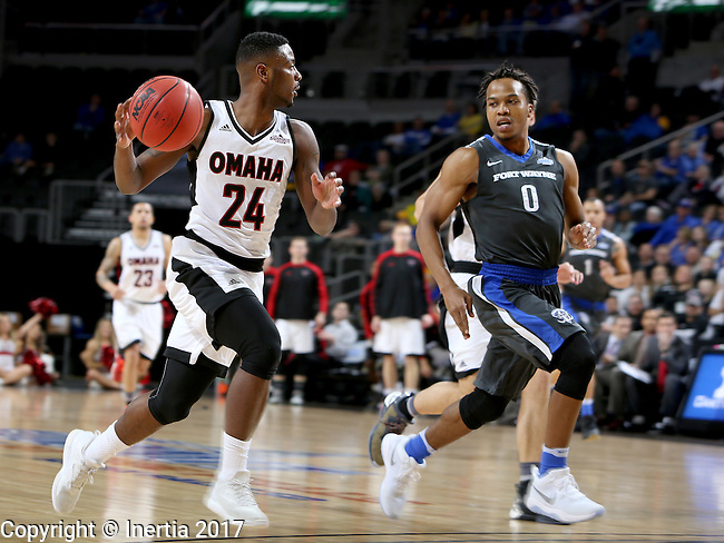 SIOUX FALLS, SD: MARCH 5: 	Tra-Deon Hollins #24 from Omaha pushes the ball past Mo Evans #0 from Fort Wayne during the Summit League Basketball Championship on March 5, 2017 at the Denny Sanford Premier Center in Sioux Falls, SD. (Photo by Dave Eggen/Inertia)