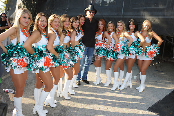 Trace Adkins poses with the Miami Dolphons Cheerleaders backstage at the 99.9 Kiss Country Chili Cookoff concert held at C.B. Smith park on January 30, 2011 in Pembroke Pines Florida. © MediaPunch Inc. / MPI04