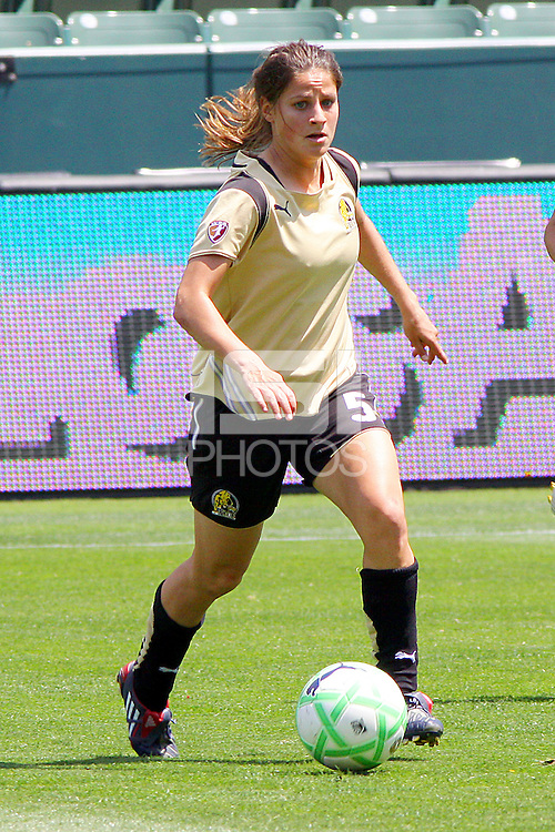 Tina DiMartino #5 of FC Gold Pride attacks the defense the Los Angeles Sol during their match at Home Depot Center on April 19, 2009 in Carson, California.