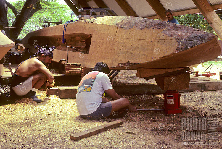 Building Polynesian voyaging canoe, Hawai'iloa - one hull, spruce log, of canoe is turned over to begin carving out inside; Halau Waa, Bishop Museum..4/13/91