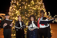 Christmas carolers sing in old-fashioned style during the annual Christmas tree lighting event at Birkdale Village in Huntersville, NC. Birkdale Village combines the best of shopping, dining, apartments and entertainment venues within a 52-acre mixed-use development.