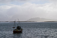 Single fishing boat moored near Eggum, Vestvagoy, Lofoten Islands, Norway