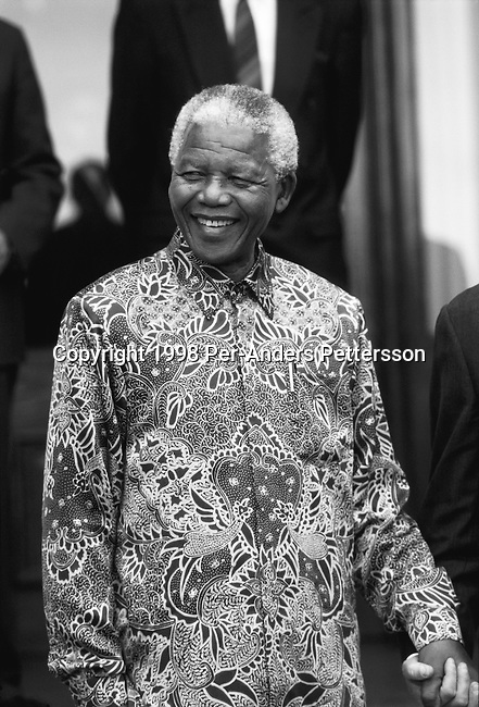 PRETORIA, SOUTH AFRICA - SEPTEMBER 25: Former President Nelson Mandela of South Africa smiles as he greets people outside his home September, 25 1998 in Pretoria, South Africa. The ANC freedom fighter was in prison for 27 years and released in 1990. He became President of South Africa after the first multiracial democratic elections in April 1994. Mr Mandela retired after one term in 1999 and gave the leadership to the current president Mr Thabo Mbeki. (Photo by Per-Anders Pettersson)