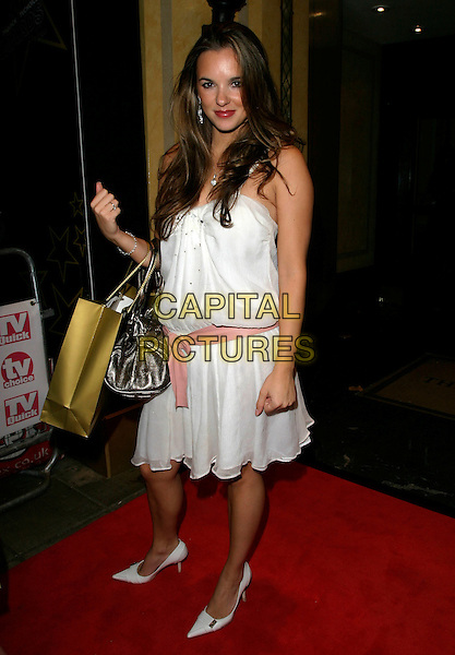 JODI ALBERT.Leaving the TV Quick & TV Choice Awards 2006,.The Dorchester Hotel, London, England,.September 4th 2006..full length white dress pink sash gold goody bag jodie.Ref: AH.www.capitalpictures.com.sales@capitalpictures.com.©Adam Houghton/Capital Pictures.