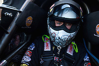 Mar 30, 2014; Las Vegas, NV, USA; NHRA top fuel driver Steve Torrence seated in his cockpit during the Summitracing.com Nationals at The Strip at Las Vegas Motor Speedway. Mandatory Credit: Mark J. Rebilas-