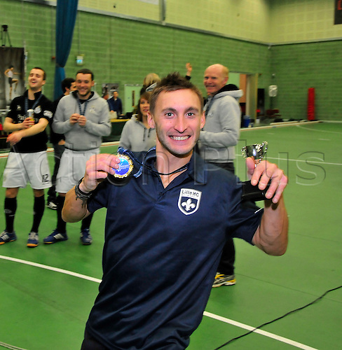 19.02.2012  EuroHockey Indoor Club Trophy, Engage Sports Centre, Napier University, Edinburgh..Finals Day 3. The player of the tournament, Mikael Klemph of Lille (FRA)with his trophy.