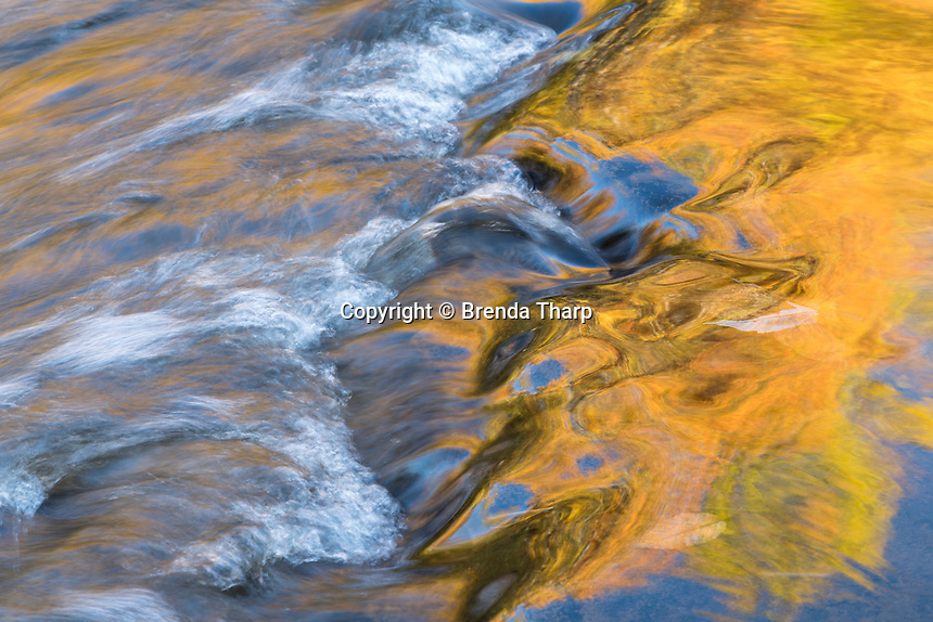 Autumn colors reflect in the Presque Isle River, Wisconsin.