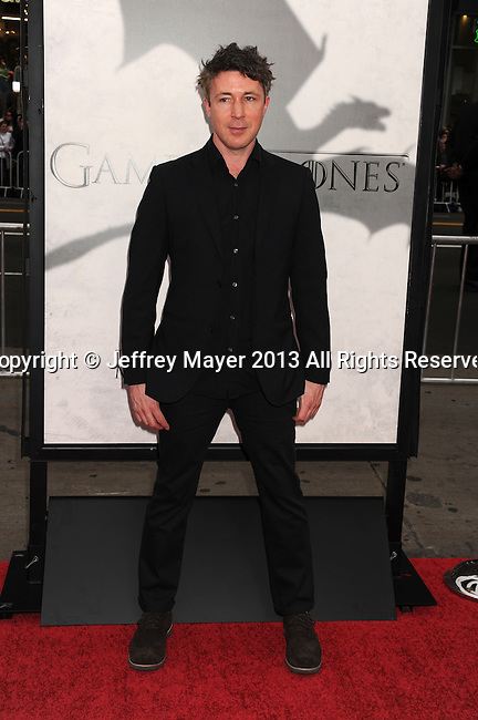 """HOLLYWOOD, CA - MARCH 18: Aiden Gillen.. arrives at the Los Angeles premiere of HBO's """"Game Of Thrones"""" Season 3 at TCL Chinese Theater on March 18, 2013 in Hollywood, California."""