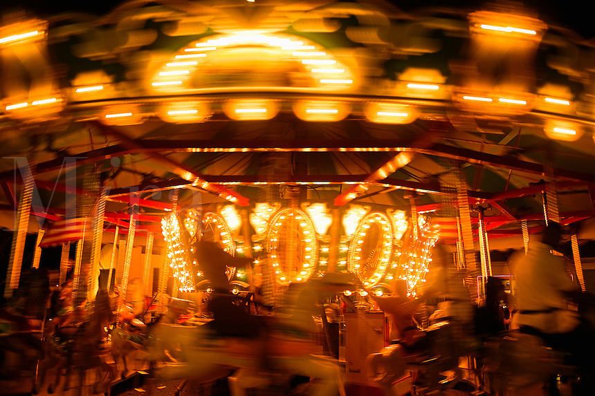 Merry-go-round ride in motion.