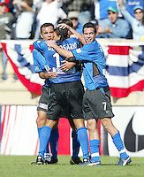 24 October 2004: (from left to right) Ramiro Corrales, Dwayne De Rosario and Ian Russell celebrate with Rosario after Rosario scored a goal in the first half of the game against Wizards at Spartan Stadium in San Jose, California.   Earthquakes defeated Wizards, 2-0.  Credit: Michael Pimentel / ISI