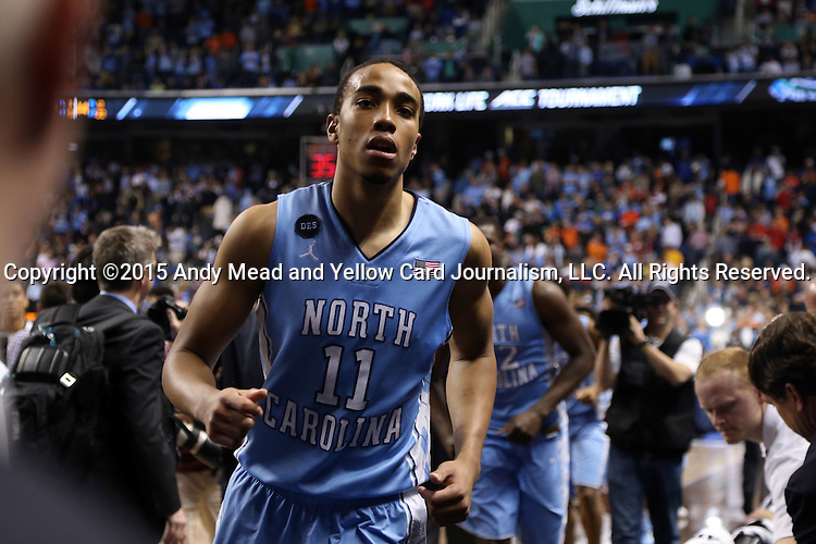 13 March 2015: North Carolina's Brice Johnson jogs off the court after the game. The University of Virginia Cavaliers played the University of North Carolina Tar Heels in an NCAA Division I Men's basketball game at the Greensboro Coliseum in Greensboro, North Carolina in an ACC Men's Basketball Tournament semifinal game. North Carolina won the game 71-67.