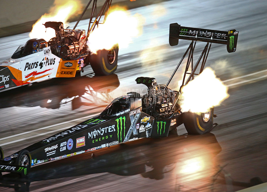 Jul 23, 2016; Morrison, CO, USA; NHRA top fuel driver Brittany Force (near) races alongside Clay Millican during qualifying for the Mile High Nationals at Bandimere Speedway. Mandatory Credit: Mark J. Rebilas-USA TODAY Sports