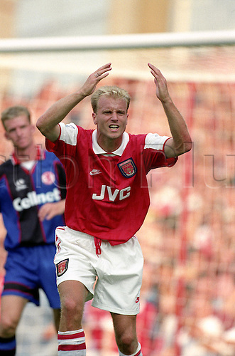 20 August 1995: Arsenal striker Dennis Bergkamp shows frustration and disbelief during the Premier League match between Arsenal and Middlesbrough at Highbury. The  match was drawn 1-1. Photo: Glyn Kirk/Actionplus..950820 football soccer man men player footballer frustrated upset surprised