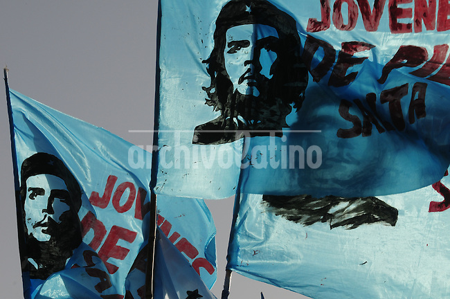 """Flags with the face of  Ernesto """"Che"""" Guevara are seen at the inauguration of a statue at his birthplace of Rosario.The two-ton, four-metre bronze statue of """"Che"""" Guevara was unveiled on  in the Argentine city where he was born exactly 80 years ago, the first such monument to the revolutionary in his homeland."""