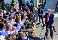 United States President Donald J. Trump takes questions from reporters as he prepares to depart the South Lawn of the White House in Washington, DC to spend a week at the Trump National Golf Club Bedminster in Bedminster, New Jersey on Friday, August 9, 2019.<br /> CAP/MPI/RS<br /> ©RS/MPI/Capital Pictures