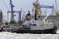 Cargo boat (ship) with cranes in Elbe near docks of Hamburg port