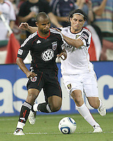 Julius James #2 of D.C. United about to be grabbed by Fabian Espindola #7 of Real Salt Lake during an MLS match at RFK Stadium, on June 5 2010 in Washington DC. The game ended in a 0-0 tie.